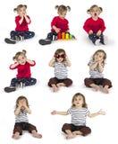 Uppsättningen av behandla som ett barn flickasammanträde, och danande gör en gest Arkivbilder