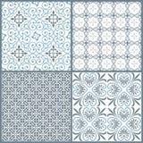 Uppsättningen av fyra dekorativa symmetriska seamless för tappning mönstrar Arkivbild