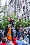 Uppta rörelse som protesterar mot social och ekonomisk inequalit arkivfoto