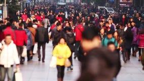 Upptagen folkmassatrafik på den Nanjing vägen, Shanghai lager videofilmer