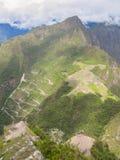 Upptill - en sikt av Machu Picchu från det Wayna Picchu berget Royaltyfri Foto