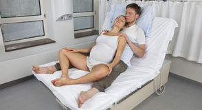 Upright birth position, sitting with partner Stock Photography