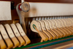 Upright black piano hammer. Detail Stock Photos
