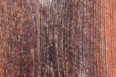 Upright board wall with worn old reddish paint Stock Images