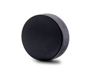 An Upright Hockey Puck Isolated on White Background Stock Image
