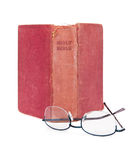 Upright Old Bible and Reading Glasses Stock Photography