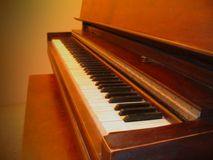 Upright Piano. In soft lighting Stock Image