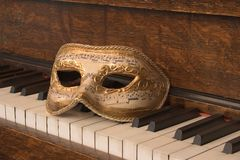 Upright Piano_8095-1S. Close-up of Piano Keys with Opera Mask Royalty Free Stock Image
