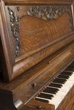 Upright Piano_8104-1S. Side View of an Antique Oak Piano stock image