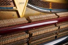 Upright piano. Close up of mechanics inside of an upright piano Royalty Free Stock Photo