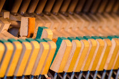 Upright piano dampers Royalty Free Stock Images
