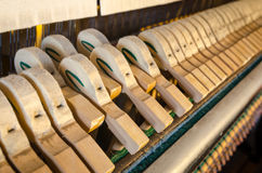 Upright piano hammers detail. With hammers pressed Royalty Free Stock Photos