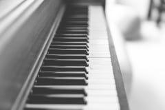 Upright piano keyboard or piano keys. Black and white piano keys on a wooden upright piano Royalty Free Stock Image