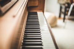 Upright piano keyboard or piano keys. Black and white piano keys on a wooden upright piano Royalty Free Stock Photography