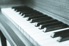 Upright piano keyboard or piano keys. Close-up view of keys on an antique, wooden, upright piano Royalty Free Stock Image