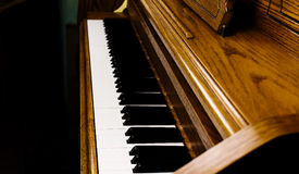 Upright Piano Keyboard Tight Shot Of Keys And Wood. Tight Shot Of Upright Piano Keyboard And Surrounding Wood Stock Images