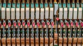 Upright piano mechanics. Detail of an upright piano mechanics.. single key pressed Stock Image