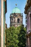 Upright view on the southern tower of the Berliner Dome through an alley with the Zeughaus to the right royalty free stock images