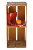 Upright wood crate isolated with bag & orange Royalty Free Stock Images