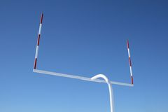 Uprights of football goal posts. Uprights of American football goal posts against the blue sky stock images