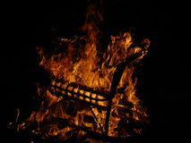 Uprising. Chair goes up in flames after tensions Stock Photos