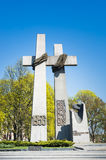 1956 uprising monument. POZNAN, POLAND - APRIL 10, 2017: The 1956 uprising monument in cross shape by a park on a sunny day Royalty Free Stock Photo