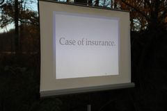 Case of insurance with projection screen. Uprooted tree in a forest with projection screen, beamer and notebook. All equipment is working Stock Photography