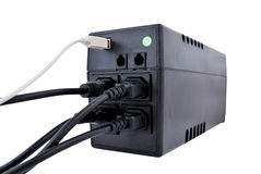Ups. Wires connected to an ups on a white background Royalty Free Stock Image