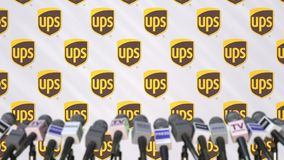 UPS company press conference, press wall with logo and mics, conceptual editorial 3D rendering. Company press conference, conceptual editorial 3D stock illustration