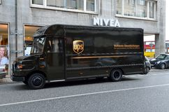 Ups delivery black car on the street Stock Photo