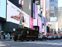 UPS Delivery Truck in Times Square in New York City. UPS Delivery truck driving through Times Square on its way to make it`s deliverys to customers royalty free stock photos