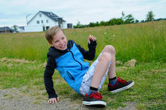 Ups I am falling down. Laughing boy falling down on the ground stock photos