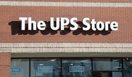 UPS Store Retail Business. A United Parcel Serivce shipping, packaging and postal retail business sign stock photo