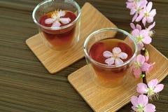 Сups of tea with blossom branch. Сups of tea with blossom pink flowers cherry branch. Selective focus Royalty Free Stock Photos
