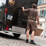 UPS truck and delivery man stock photography