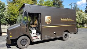 UPS Truck. Walnut Creek, United States - September 22, 2016: United Parcel Service (UPS) delivery truck parked in the parking lot of a suburban apartment complex Royalty Free Stock Photos