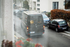 UPS van leaving view from window. PARIS, FRANCE - DEC 10, 2015: POV of customer at UPS United Parcel Service van delivery brown ups van leaving after dlivering Royalty Free Stock Images