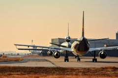 UPS A300 and a Western Global Airlines MD11F taxi out to the runway royalty free stock image