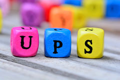 Ups word on table. Ups word on wooden table Royalty Free Stock Images
