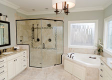 Upscale bathroom. With a modern tub and tile floor Stock Photography