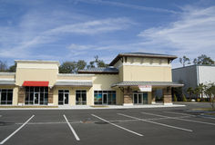 Upscale beige strip mall Royalty Free Stock Photo