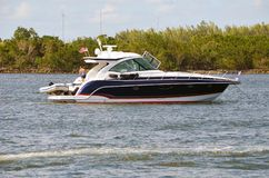 Upscale Cabin Cruiser at Anchor in Haulover Beach Inlet Stock Image