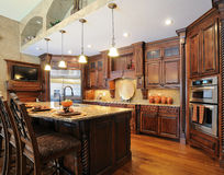 Upscale contemporary custom kitchen  Royalty Free Stock Image