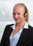 Upscale customer representative. Blond, caucasian beautiful female customer representative with headset ready for serving your customers Royalty Free Stock Photography