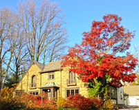 Upscale family house decorated with autumn foliage Stock Images