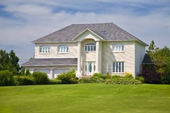 Upscale Home. Large upscale family home with a beautiful lawn Stock Image