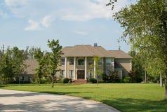 Upscale Home. Beautiful, upscale home on landscaped acreage Stock Photos