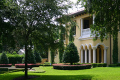 Upscale Home. Upscale yellow Spanish-style stucco home with well-manicured grounds Royalty Free Stock Images
