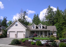 Upscale Home. Luxury house in wooded neighborhood with immaculate landscaping stock photography