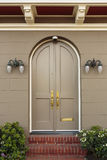 Upscale Home Arched Closed Front Doors Stock Images